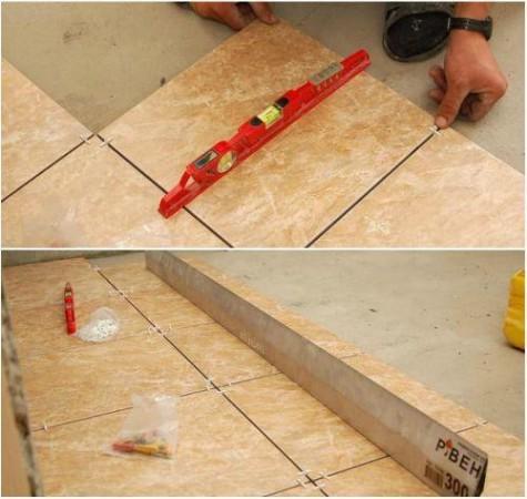 Каждую положенную плитку обязательно проверяем уровнем, а ряд рейкой, чтобы не было перекосов